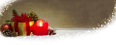 出现蜡烛和雪 库存照片