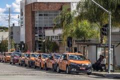 出租汽车库里奇巴中止街市  免版税库存照片