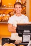 出纳员在面包店商店 免版税库存照片