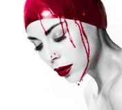 出血妇女的剧烈的画象 免版税图库摄影