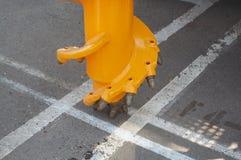 凿岩机黄色 库存图片