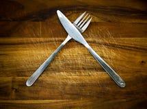 刀叉餐具木头 免版税库存图片