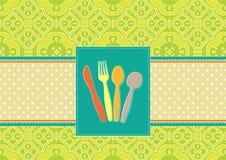 刀叉餐具看板卡有锦缎背景 免版税库存图片