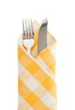 刀子和叉子在餐巾 免版税库存图片