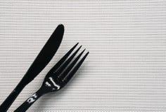 黑刀子和叉子 库存照片