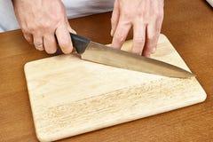 刀子手中厨师 免版税库存照片