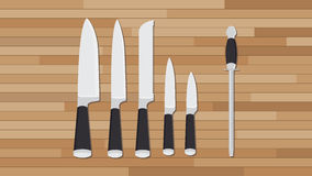 刀子汇集厨房设置有木背景 图库摄影