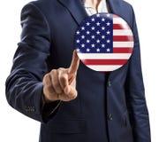 分享泡影的商人与美国旗子 图库摄影