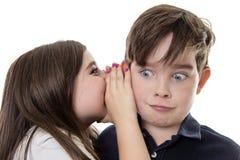 分享秘密的孩子 图库摄影