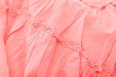 分割女孩的一条桃红色裙子。 库存照片