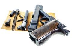 分开的零件手枪 图库摄影