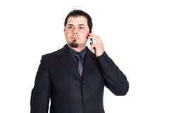 分散的电话的商人 免版税库存照片