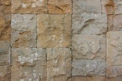 切削的石墙背景 库存照片
