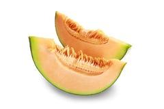 切在白色backgroun的橙色瓜果子 库存图片