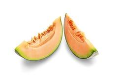 切在白色backgroun隔绝的橙色瓜果子 免版税库存照片
