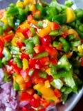 切好的和切成小方块的辣椒的果实 免版税库存照片