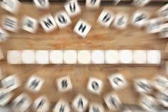 切成小方块与十一个信件或文本企业概念的copyspace 图库摄影