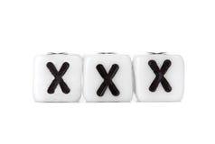 切成小方块与形成词的信件:xxx 免版税图库摄影