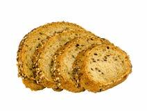 切片五谷在自由裁减上添面包在白色backround 库存图片