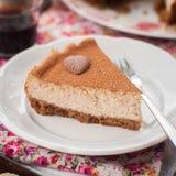 切片加香料的咖啡乳酪蛋糕 免版税库存照片