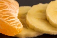 切片果子特写镜头普通话和香蕉 库存图片
