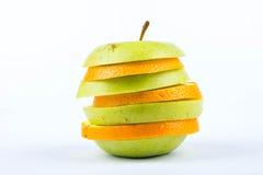 切片苹果和桔子 免版税库存照片
