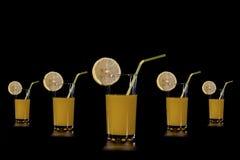 切片结果实的柑桔杯子橙汁 免版税图库摄影