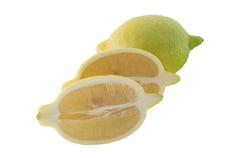 切的柠檬和绿色柠檬 免版税图库摄影