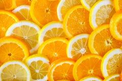 切的桔子和柠檬抽象背景  库存图片