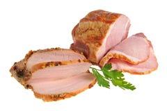 切的烟肉和火鸡与被隔绝的荷兰芹绿色叶子  图库摄影