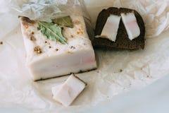 切的猪肉猪油用面包 库存图片