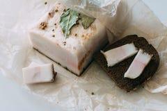 切的猪肉猪油用面包 免版税库存图片