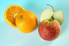 切的苹果桔子 免版税库存图片