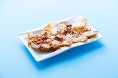 切的被烘烤的土豆 库存图片