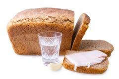 切的面包和饮料 免版税库存图片