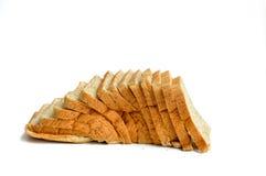 切的麦子面包 查出在白色 库存照片