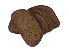 切的黑面包,隔绝在白色 库存图片