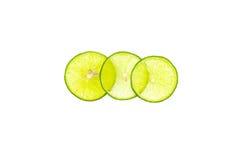 切的绿色柠檬和在白色背景堆积了隔绝 免版税图库摄影