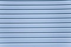 切蓝色房屋板壁 免版税库存图片