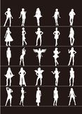 White silhouette female standing on a black background. Vector illustration. Twenty five white silhouette females standing on a black background. Vector royalty free illustration