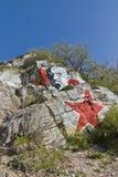 列宁和红色星画象在岩石。 库存图片