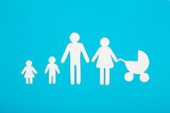 系列的纸板形象在一个蓝色背景 标志 库存照片