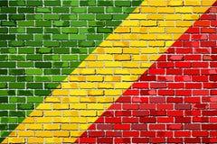 刚果共和国旗子在砖墙上的 图库摄影