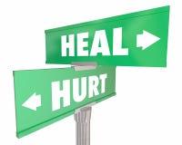 创伤对愈合伤害补救两路路牌 库存图片
