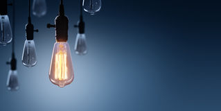 创新和领导概念-发光的电灯泡 免版税库存照片