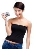 创造性的女孩拿着非职业手扶的照相机 免版税库存图片
