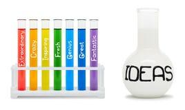 创造性的概念与色的烧瓶的。 免版税库存图片