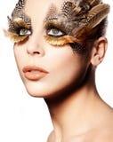创造性的眼睛用羽毛装饰构成 免版税库存照片
