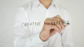 创造性的营销,写在玻璃 库存照片