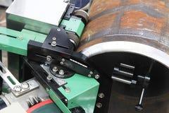 创造的斜面机器在管子 库存图片